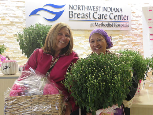 best-friends-celia-stookbury-wins-state-of-mind-door-prize-and-teresa-cruz-wins-one-of-the-pink-mums-2